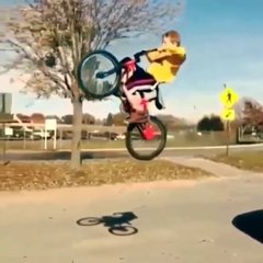 Thumbnail of Kid gets some serious air at the skate park on his bike... Doesn't stick the landing