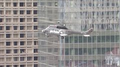 Thumbnail of Installation of the Incity tower spire by helicopter