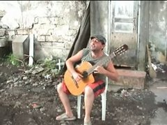 Thumbnail of Man plays guitar and turns environment into a happy one