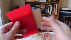 Thumbnail of Can you figure out how to fit the square inside the bag?