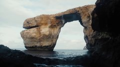 Thumbnail of Huge rocks come loose as cliff jumper leaps from 92 Feet! (Azure Window - GoT location)