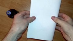 Thumbnail of Opening a beer with a sheet of paper