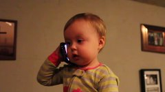 Thumbnail of Baby talks to Dad on the Telephone