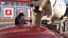 Thumbnail of Russian husband fills wife's car with cement.
