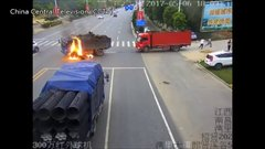 Thumbnail of Truck driver rescues motorcyclist after scary crash in Jiangxi Province in China