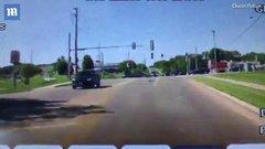 Thumbnail of Man jumps into moving car.