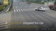 Thumbnail of Policeman stop traffic with car to guide elderly walker
