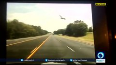 Thumbnail of Dashcam video captures small plane crashing into highway