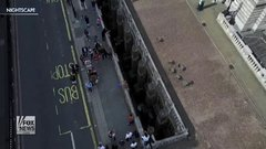 Thumbnail of Daredevil somersaults over London's Somerset House gap