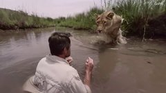 Thumbnail of The \'lion whisperer\' gets a \'hug\'.