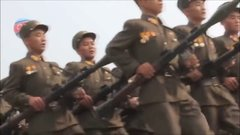 Thumbnail of Bee Gees music over North Korean marching