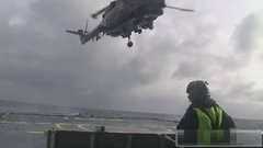 Thumbnail of Lynx helicopter landing on ship in rough sea