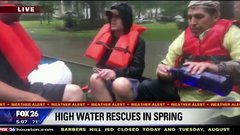 Thumbnail of Boaters helping rescue flood victims pound shots of vodka; news anchor think it's water