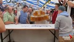 Thumbnail of German man sets new record for carrying beer steins