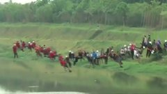 Thumbnail of 245 people jump off a bridge together