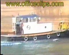 Thumbnail of Ship drops anchor on tug boat.