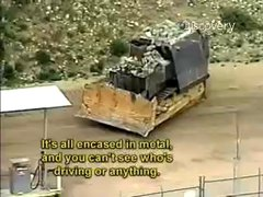 Thumbnail of Armored bulldozer takes on town.