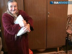 Thumbnail of 76 yrs old granny tears up a big book like it's nothing and lifts 24 kg. dumbbels