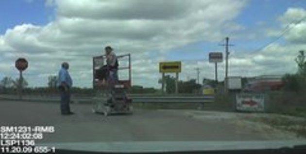 Drunk man on scissor lift