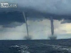 Thumbnail of Twin-tornados chasing boat