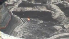 Thumbnail of Throwing a Box of Garbage Into a Volcano Lake